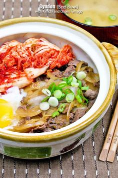 This flavorful Gyudon (Beef Bowl) topped with simmered beef, soft cooked egg, and cabbage kimchi makes a delicious and comforting meal. Asian Recipes, Beef Recipes, Ethnic Recipes, Asian Foods, Rice Recipes, Yummy Recipes, Onsen Tamago, Gyudon