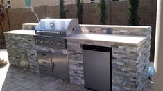 Built-in BBQ with cultured stone and travertine top