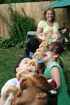Doughnut on a string party game! Too fun!  Halloween doughnuts would be fun for the neighborhood party :)
