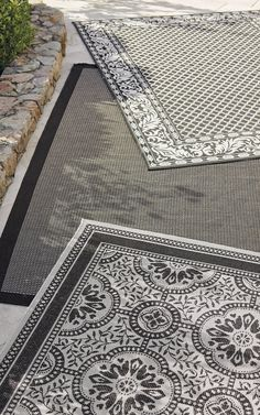 Our superbly woven Ashworth Indoor/Outdoor Area Rug beautifies every outdoor space. The easy-care, flat-weave rug shrugs off nature's worst without sacrificing style. A scrolling leaf design juxtaposed with a crisp hexagonal pattern creates the handsome design.
