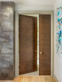 Modern interior swing door featuring a wood slab panel with anodized mid2mod a trendspotting guide to interior and exterior doors modern interior doors planetlyrics Gallery