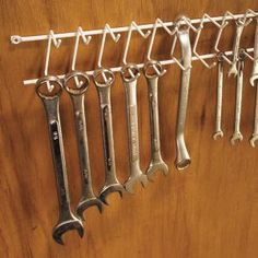 Hang wrenches on a tie/belt rack. Screw a tie/belt rack (available at discount stores) to a bare spot on the wall over your workbench and hang the wrenches—SAE and metric—where you can swiftly nab and put them away in an orderly fashion.