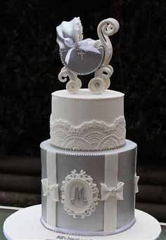 89d8a7d101f1 Looks more like a christening color cake instead Previous Pinner Elegant  Silver   White baby shower cake