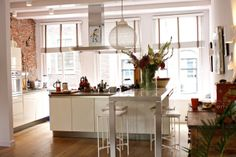 cool idea: island table over island cabinets. even better, add casters to table so it slide out for more counter space. Maria & Eric's Creative, Comfortable Home in Amsterdam House Tour Home, Home Kitchens, Exposed Brick, Sweet Home, House, Kitchen Interior, Beautiful Kitchens, House Interior, Ideal Home