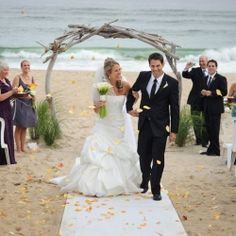 A ceremony arch built by the groom and lots of other groom inspired ideas in this Montauk beach wedding.