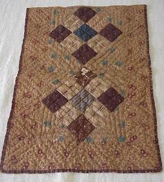 EARLY 19TH C PENNSYLVANIA BROWN CALICO DOLL QUILT        early browns in calico's … hand quilted