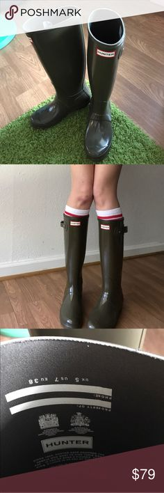 """Hunter tall gloss rain boots in swamp green 7 Barely used Hunter tall rain boots in high gloss swamp green. US women's 7, UK 5, EU 38. I am 5'8"""" for reference. Grass will be cleaned off soles, just wanted to give an honest idea of amount of wear. Doesn't come with original box. I bought them in a 7 cuz I read they ran super big, but I always wore with socks and they're a lil too small. Retails for $150. Asking for $79 or best offer. I don't think they make this color anymore! #olive #wellies…"""