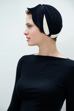 This hat is a one of a kind, hand draped 1930s style. The color is black and white. I custom fit each hat before shipping, so please send me your measurements when you purchase your hat. Thank you so much.  P.S. My sweet and beautiful model is Helena Bianca! Please take a look at her Etsy shop http://www.etsy.com/shop/helenabiancastudios