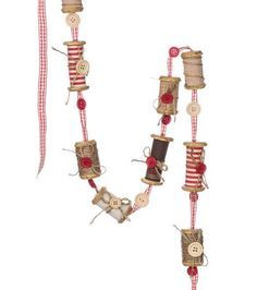 """Spools, ribbon and buttons strung on a gingham ribbon garland. - 48"""" fabric, twine and wood spool garland. - Imported."""