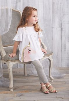 "Jersey short sleeve tunic features poplin chest piecing with ruffle sleeves, glitter printed ""fantastical"" sentiment, gold lurex neckline piping, chest pocket with gold star studs and cotton spandex unicorn applique with sequin, printed glitt Baby Outfits, Outfits Niños, Baby Girl Dresses, Baby Dress, Kids Outfits, Pink Dresses, Fashion Outfits, Fashion Trends, Little Girl Fashion"