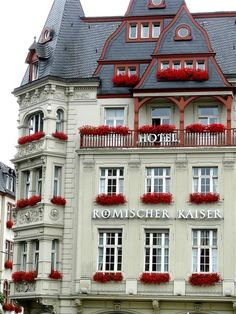 The Hotel Römischer Kaiser (Roman Emperor)  in the town of Bernkastel-Kues an der Mosel - Germany  decorated for the summer with window boxes of red blooming Geraniums.