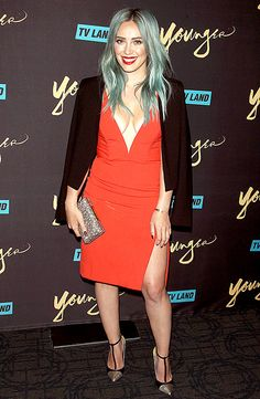 Hilary Duff stepped out to premiere her new TV Land series, Younger, in NYC on Tuesday, March 31, where she absolutely slayed the red carpet in a plunging red-orange dress that flaunted all of her assets.