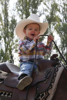 little cowboys / reminds me of our little cowboy Emmerson. Following in his Aunties, Moms, Grandma's footsteps. 2014