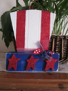 Perfect for your 4th of July decor, Uncle Sam's top hat, Wood Sign Shelf, Summer Seasonal Home Decor Gift. via Etsy.
