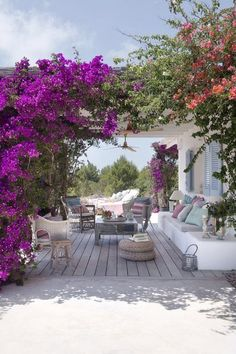 Casual neutral outdoor patio with a covered gazebo and hot pink bougainvillea.