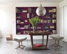Bookcase Styling Ideas We Stole From the Pros : Make your bookshelves pop by painting them a similarly bold, bright shade, like Benjamin Moore's Elderberry Wine.  Source: Elle Decor