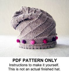A knitting pattern for a fun and modern slouchy hat with bobbles and a textured spiral design. The JO slouchy - designed with love for comfort,