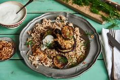 Olia Hercules' Spiced Aubergine Mujadarra with Shallot Garnish and Yogurt | Veggie Desserts Blog The humble Middle Eastern dish of lentils and rice has made a comeback as a simple but flavourful meal that can be jazzed up with delicious trimmings. Olia's version of the pilaf is combined with spiced, roasted aubergine rounds and topped with natural yoghurt, fresh dill and golden, crispy shallots. Vegetarian and easy to make vegan