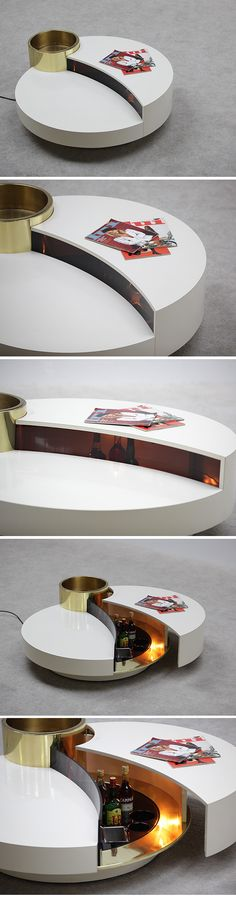willy rizzo coffee table with lamp, bottle holders, and small ice bucket.