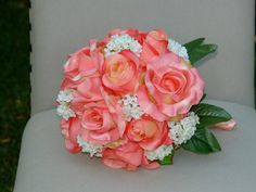 My bouquet. More white and less coral,  maybe baby's breath instead of the green leaves