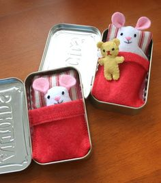 Tiny toys bunking in Altoid tins