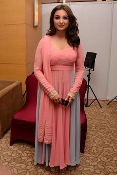 Parineeti Chopra donned a pink and grey outfit at the Mijwan Fashion Show. #Style #Bollywood #Fashion #Beauty