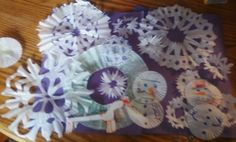 Here is an easy Christmas craft to do with the kids:   You will need Coffee Filters, paper muffin tin liners regular size or mini   Scissors,   markers and glue or tape   Just fold the coffee filters in half as many times as you can, cut out shape   and the middle for snow flakes   For Snowmen, use marker and draw the face and hat, on anoter one draw details for the body and glue or tape together. Then hang in your window or on the wall. It's inexpensive and fun.