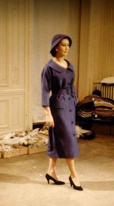 1957 - Alla in a Christian Dior day dress and matching hat, Paris, . Photo by Loomis Dean.