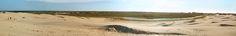 Kystklitter. En klit er i geografi en bakke af sand dannet af vindens bevægelser.  Former for Klitter:  Vandreklitter: Klitter, der ikke sikres, kan vandre langt i løbet af forholdsvis kort tid. Den største vandreklit i Danmark, som nu er fredet og altså får lov til at bevæge sig frit, er Råbjerg Mile ved Skagen. Klitten bevæger sig i øst-vestlig retning og er formet som en såkaldt parabelklit med to lange parabel-arme, der strækker sig mod vest. Den andenstørste vandreklit i Danmark er…
