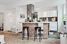 one-room Scandinavian apartment brick kitchen island