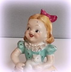 A perfect gift for your granddaughter - or any special little one - is this very sweet little glazed ceramic girl figurine! She sits daintily on any ledge holding her kitty with a pink bow in her hair. Shes absolutely adorable and was created mid century in Occupied Japan - a real treasure!  ~ She measures 5.5 high and remains in excellent vintage condition with no chips or cracks  Thanks for stopping by! Find a garden full of other treasures at www.etsy.com/shop/izzysvintagegarden ...