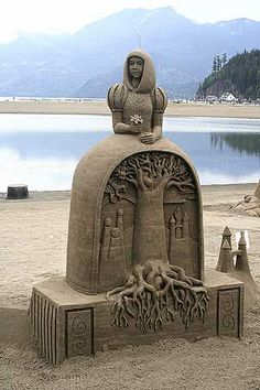 Sand Art is the practice of modelling sand into an artistic form, such as a sand brushing, sand sculpture, sand painting, or sand bottles. A sand castle is a type of sand sculpture resembling a min… Snow Sculptures, Art Sculpture, Statues, Ville New York, Oregon Beaches, Ice Art, Snow Art, Cemetery Art, Grain Of Sand