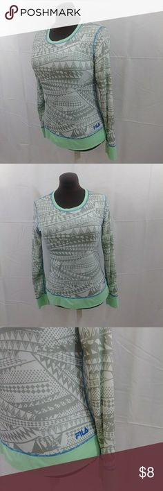 Fila active top Long sleeved with a tribal style design. Soft gray, green and blue stiching. Double layered fabric-lined. Fila Tops Tees - Long Sleeve
