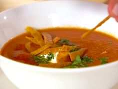 Food Network invites you to try this Tomato-Tortilla Soup recipe from Ellie Krieger.