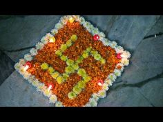 Making special swastik rangoli with flowers, Flowers rangoli for goddess lakshmi, Special rangoli design on marriages and functions and vrathams Flower Rangoli Images, Rangoli Designs Flower, Rangoli Designs Diwali, Marigold Flower, Flower Petals, Flowers, Diy Diwali Decorations, Flower Decorations, Special Rangoli