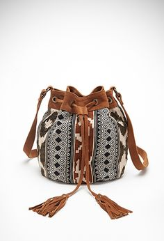 Combining tribal print and fringe tassels in the it-shape for Spring. It's a trend finders dream bag.