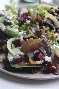Mixed Greens with Roasted Beets, Caramelized Onions, Goat Cheese and Pistachios