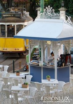 A cafe terrace served by an art nouveau kiosk from 1909, by the Estrela basilica.