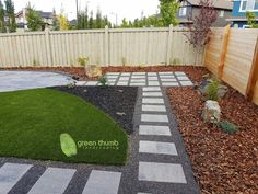 The concrete slabs make for a great clean modern look with patios and walkways. The medium bark mulch, black mulch and artificial Turf help to soften the look.