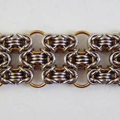 This slight variation on the standard Byzantine weave probably has an official name, but I've been referring to it as honeycomb due to the pattern created by the larger rings. Silver Rings Handmade, Sterling Silver Rings, Handmade Jewelry, Photo Jewelry, Wire Jewelry, Jewelry Crafts, Jewelry Ideas, Chain Mail, Diy