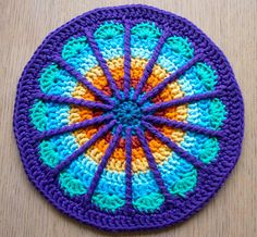 This week's weekly mandala is inspired by a groovy pattern found on the COLOURlovers website. A creative being makes one crochet mandala…