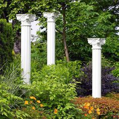 """Create Height-Give your landscape a lift by adding high points -- in this case, three 12-foot-tall classically inspired concrete columns that stand like exclamation points. """"The idea is to lift the eye up off the ground,"""" Brian says. """"The pillars create a sense of antiquity and add an element of surprise and mystery."""" The scene is striking in summer when the surrounding garden shimmers in white with astilbe, actaea, phlox, and silvery maidengrass."""