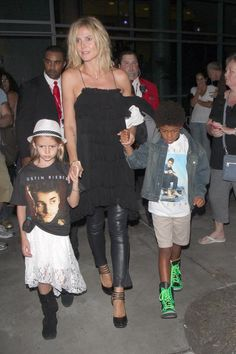 German supermodel Heidi Klum and her new boyfriend Martin Kirsten take the kids Leni, Johan and Lou out to see Justin Bieber in concert at The Staples Center in downtown Los Angeles