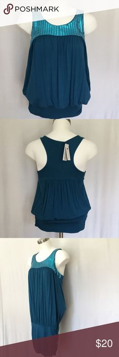 Charming Charlie Top  Charming Charlie's Tank Top in pretty teal. Soft fabric with pretty sequined neckline. Has really nice hip side gathers to hold top in place and looks awesome on. Brand new with tags. Charming Charlie Tops