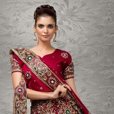 The Magenta colour here is ever beautiful, but the netting touch to the dupatta would never fail to impress