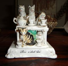 Victorian Fairing Cats at Five Oclock Tea Conta Boheme.   (nota:This little piece was actually a prize handed out to people in the Victoria Era when they won something at the fair. ) Note from Debbie: Aargh. I had one of these and I sold it. Why do I even think about selling my cat figurines? I always regret it.