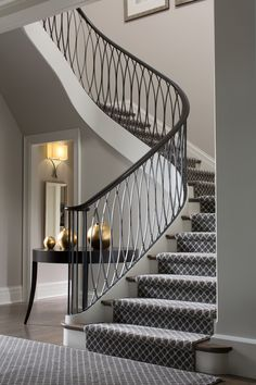 Stunning white stairway with carpet runner, iron railing, wood flooring | Bayview Builders