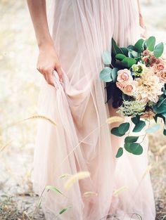 blush pink wedding dress and greenery rose bouquet