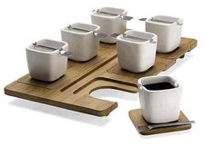 serving tray with square mugs and removable coasters.
