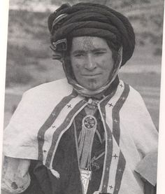 A Muladi(Mixed Berber Woman),Kabyle Tribe.Algeria,Africa.Alot Of These types have the blood of the Germanic Vandal who visited Barbary North Africa and bred with the local Black Moorish Numidian Tribes producing a lighter strain,add in the Modern French during Colonial North Africa and their you have it the Modern Kabyle socalled Berber.